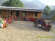 CDC women in meeting infront of the building made by them
