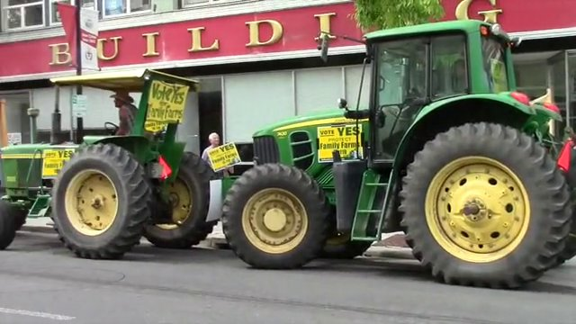 Family Farmers Tractor Downtown Medford for Protection from GMOs