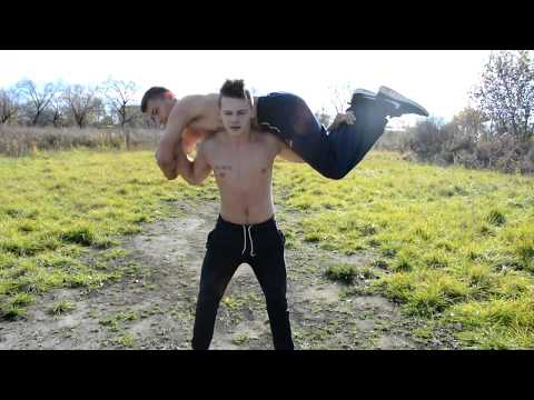 Young teenager 17 years old, wrestling with muscles, demonstrating his strength and perfect muscles