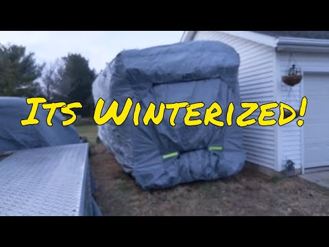 How I winterize my camper and the best RV cover I can find!