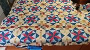 Frolic quilt top being pieced together blocks and sashing.