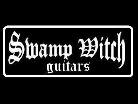 Woman in black Swamp witch guitar