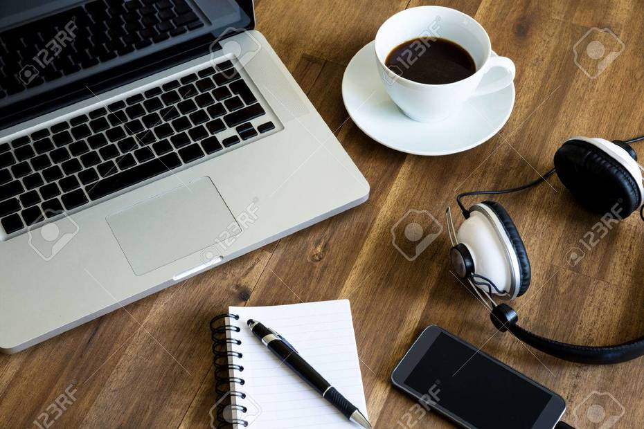41245306-working-with-the-laptop-taking-notes-and-drinking-a-coffee