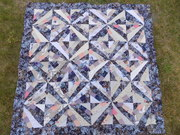Oh, what a lovely quilt awaiting binding. 001