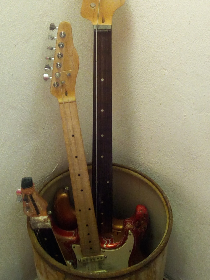 1string bass lyra with bow and 2string two fretless guitars using for chords n rythm
