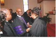 BISHOP HOLMES SHAKES HAND OF ORDAINED ELDER REV. DR. MARTHA ANDREE' LEWIS AT THE CLOSING OF HOLY ORDERS CEREMONY MARTHA CONFIRMED AS ELDER AT THE TENNESSEE AME ZION CONFERENCE