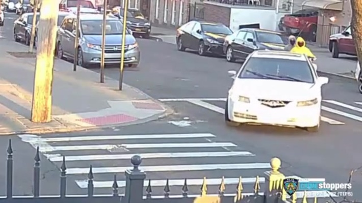 2 men on a scooter shooting into a playground